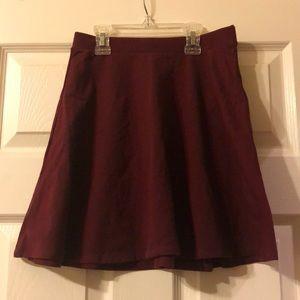 Never worn Forever 21 mini skirt. Maroon.